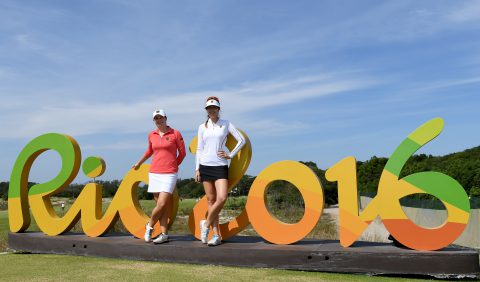 RIO DE JANEIRO, BRAZIL - AUGUST 16: Caroline Masson and Sandra Gal of Germany pose by the Rio 2016 sign prior to the Women's Individual Stroke Play golf at the Olympic Golf Course at Olympic Golf Course on August 16, 2016 in Rio de Janeiro, Brazil. (Photo by Ross Kinnaird/Getty Images)