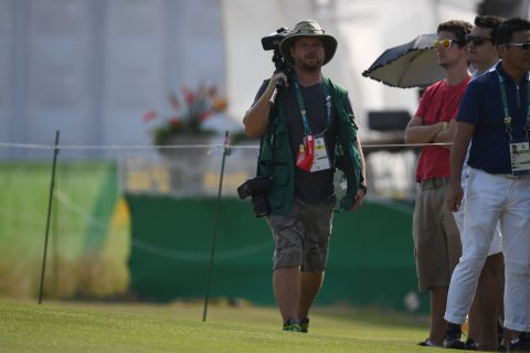 AFP Photographer Jim Watson walks the golg course during the Women's individual stroke play at the Olympic Golf course during the Rio 2016 Olympic Games in Rio de Janeiro on August 18, 2016. / AFP / Greg BAKER        (Photo credit should read GREG BAKER/AFP/Getty Images)