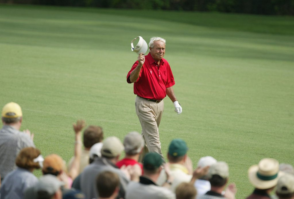 AUGUSTA, GA - APRIL 9: Arnold Palmer waves to the crowd on the 13th hole during the second round of the Masters at the Augusta National Golf Club on April 9, 2004 in Augusta, Georgia. (Photo by David Cannon/Getty Images)
