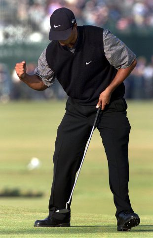ST. ANDREWS, UNITED KINGDOM: Tiger Woods of the US pumps his fist after sinking a putt to save par on the 17th hole after laying his second shot off the back of the green on the Old Course at St. Andrews during his second round of the British Open Championship 21 July 2000. Woods is the second round leader at 11-under par. (ELECTRONIC IMAGE) (Photo credit should read ADRIAN DENNIS/AFP/Getty Images)