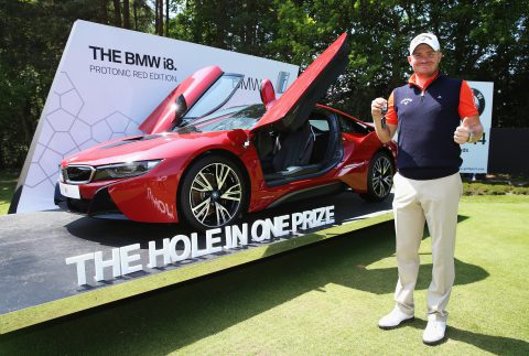VIRGINIA WATER, ENGLAND - MAY 29: James Morrison of England poses with his new BMW i8 car after his hole-in-one on the 14th during day four of the BMW PGA Championship at Wentworth on May 29, 2016 in Virginia Water, England. (Photo by Andrew Redington/Getty Images)
