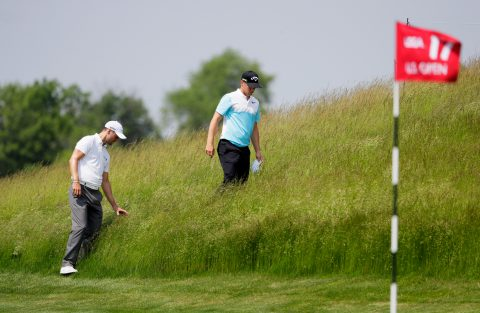 HARTFORD, WI - JUNE 12: Alexander Noren of Sweden and Martin Kaymer of Germany look for a ball on the 17th hole during a practice round prior to the 2017 U.S. Open at Erin Hills on June 12, 2017 in Hartford, Wisconsin. (Photo by Jamie Squire/Getty Images)