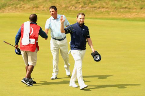 SOUTHPORT, ENGLAND - JULY 22: Branden Grace of South Africa acknowledges the crowd on the 18th green after shooting a 62, the lowest round in major history during the third round of the 146th Open Championship at Royal Birkdale on July 22, 2017 in Southport, England. (Photo by Andrew Redington/Getty Images)