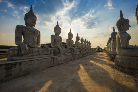 shutterstock_447598483-the-sun-setting-over-the-historic-buddha-statue-park-in-nakhon-si-thammarat