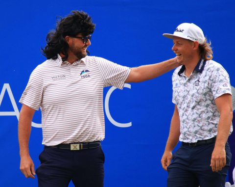 Marc Leishman of Australia wears a mullet wig as he walks out with his partner Cameron Smith of Australia on the first tee during the third round of the Zurich Classic of New Orleans at TPC Louisiana on April 24, 2021 in New Orleans, Louisiana. (Photo by Mike Ehrmann/Getty Images)