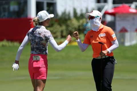 SINGAPORE, SINGAPORE - MAY 02: Hyo Joo Kim (R) of South Korea fist bumps with Sophia Popov (L) of Germany after holing out on the 18th green during the final round of the HSBC Women's World Championship at Sentosa Golf Club on May 2, 2021 in Singapore. (Photo by Lionel Ng/Getty Images)