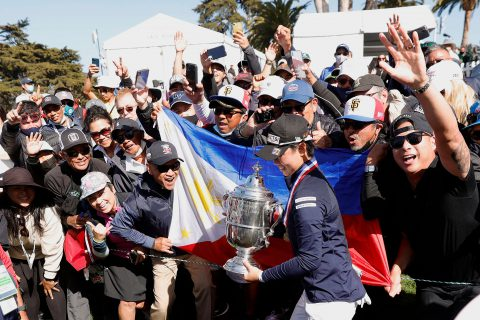 SAN FRANCISCO, CALIFORNIA - JUNE 06: Yuka Saso of the Philippines walks past fans with the Harton S. Semple Trophy after winning the 76th U.S. Women's Open Championship at The Olympic Club on June 06, 2021 in San Francisco, California. Saso won following a three-hole playoff against Nasa Hataoka of Japan. (Photo by Ezra Shaw/Getty Images)