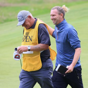 SANDWICH, ENGLAND - JULY 15: Marcel Siem of Germany reacts with his caddie as he walks off the 18th green after making a birdie during Day One of The 149th Open at Royal St George's Golf Club on July 15, 2021 in Sandwich, England. (Photo by Chris Trotman/Getty Images)