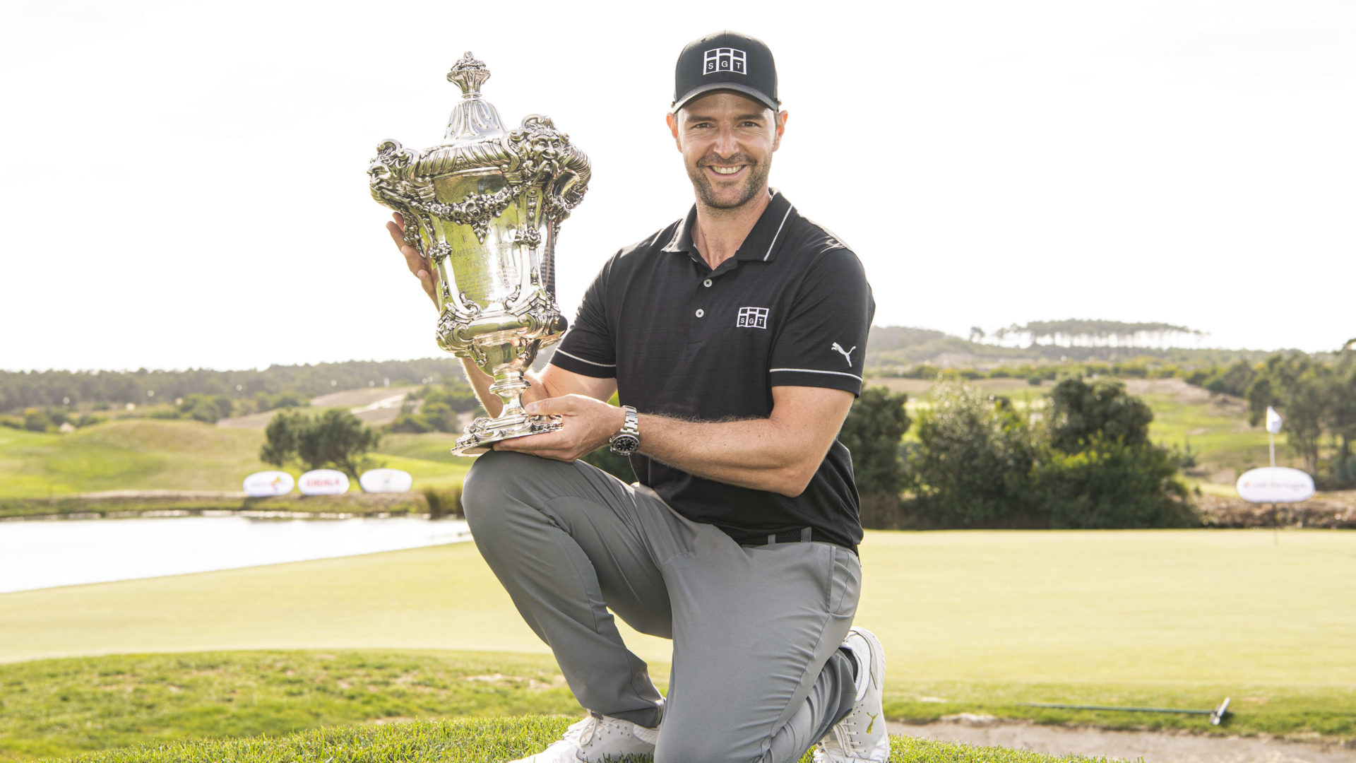 OBIDOS, PORTUGAL - SEPTEMBER 26: Marcel Schneider of Germany poses at the 18th green with the Trophy after winning the Open de Portugal at Royal Obidos at Royal Obidos Spa & Golf Resort on September 26, 2021 in Obidos, Portugal. (Photo by Octavio Passos/Getty Images)